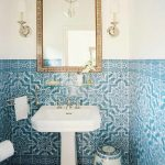 beautiful blue tile bathroom color trend with white freestanding sink and rectangle framed wall mirror and creamy floor