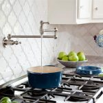 beautiful installation of beveled arabesque tile in the kitchen with modern kitchen stoves and marble countertops