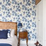 best bedroom design with wooden bddding and white closet and rattan basket and blue floral wallpaper accent