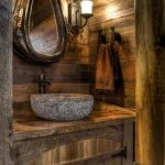 best rustic vanity design in country home interior design with wooden top and stone sink and antique wall mirror and traditional wall lamp