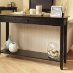 classic black console table ikea design with christmas decoration and additional storage with pottery