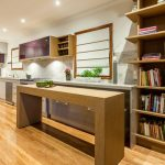 contemporary-kitchen-room-with-pull-out-table-crafted-carefully-to-fit-under-the-worktop-and-no-space-goes-to-waste-with-this-wooden-pull-out-table