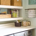 contemporary laundry room shelf ideas with metal basket mounted on the wall and cute rattan baskets decorated on the wooden shelves