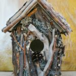 creative-and-decorative-bird-house-the-unique-rustic-bird-house-made-with-hand-split-sticks-with-wood-rounds-and-river-rocks-and-assortment-materials