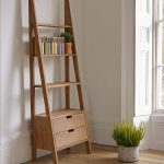 dazling ladder shelving unit made of wooden with storage beneath and wood flooring plus fresh green pot