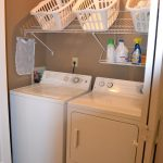 dazzling laundry room shelf ideas with metal rack and plastic laundry baskets on brown painted wall