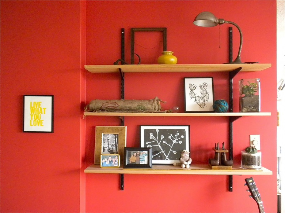 Diy Wooden Wall Shelves Design On Red Painted With Black Iron Stand And Table Lamp