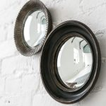 double small convex mirror set on white wall home interior