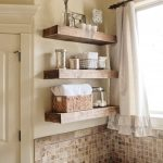Elegant Bathroom Design With Bold Wooden Shelves Design And Small Tiles Mosaic Backsplash And Modern Bathtub