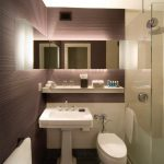 elegant soft purple and creamy color bathroom trend with freestanding sink and walk in shower