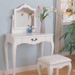 elegant white vanity design with carved style and unique white vanity chair design with bolster