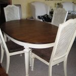 famous cane back dining chair with brown upholstery and white finish plus round wooden table decorated in narrow dining room with