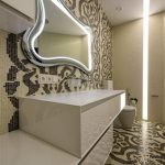 futuristic bathroom design with painted wall and flooring and floating vanity and curved wall mirror and modern lighting