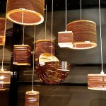gorgeous and stylish  wooden light fixture design idea hovering on the air with white yarn suspension