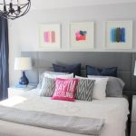 gorgeous bedroom with gray simple headboard design and wall palette and white bedding and navy blue curtain