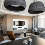 gorgeous black giant pendant shade above dining table with living space and stunning geometrical wall design and wooden floor