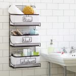 Gorgeous Black Iron Bathroom Shelves Design With Three Slots For Toilteries And Towels Aside White Freestanding Vanity Beneath White Brick Wall