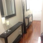 Gorgeous Black Small Console Table For Hallway With Candelabrum And Wall Mirror And Wooden Floor