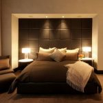 gorgeous brown bedroom theme with modern tall headboard and comfy chair for bedroom design and wooden floor