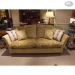 Gorgeous Creamy Patterned Sectional Sofa Clearance Idea With Beautiful Cushions And Table Lamp