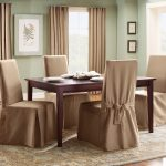 gorgeous creamy  slip cover for dining room chairs design with ribbon and wooden dining table and creamyy area rug