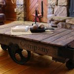 gorgeous rustic wooden cool coffee table with wheels like cart with centerpiece