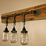 gorgeous transparent shaded bulb design with black iron pipe suspension of  wooden light fixture design