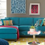 Gorgeous Turquoise Sectional Sofa Clearance Idea  Design With Round Glass Coffee Table And Yellow Patterned Area Rug And Wall Pictures