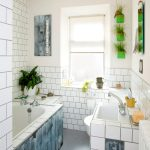 gorgeous white and blue bathroom color trend with green succulent planters and white brick wall and tile vanity