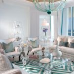 gorgeous white and green patterned scandinavian boho chic style with all white seating and unique turquoise chandelier and glass table
