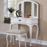 gorgeous white carved vanity design with triple folded wall mirror and stool with gray upholster