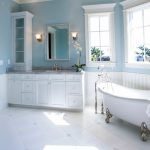gorgeous wide and comfortable white blue bathroom color trend design with vinatge bathtub and glass window