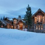 gorgeous wooden house design with snowy roof and glass window and wooden siding and large space