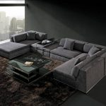 gray long sectional sofa made of fabric with brown furry rug and black glass coffee table for glamorous living room ideas