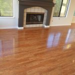 hardwood floor vs laminate with stunning fireplace together with brown mantel and glass windows