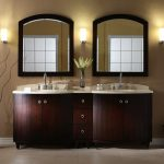 images of bathroom vanities with twin wooden cabinets and white countertops featuring modern sink and faucet plus framed mirror on wall
