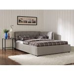 large daybed in grey with white bedding strip comforter and pillowcases white shaggy rug black framed glass top side table with black metal base
