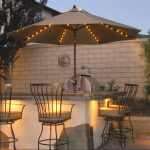 lighted patio umbrella for outdoor kitchen ideas together with brick walls