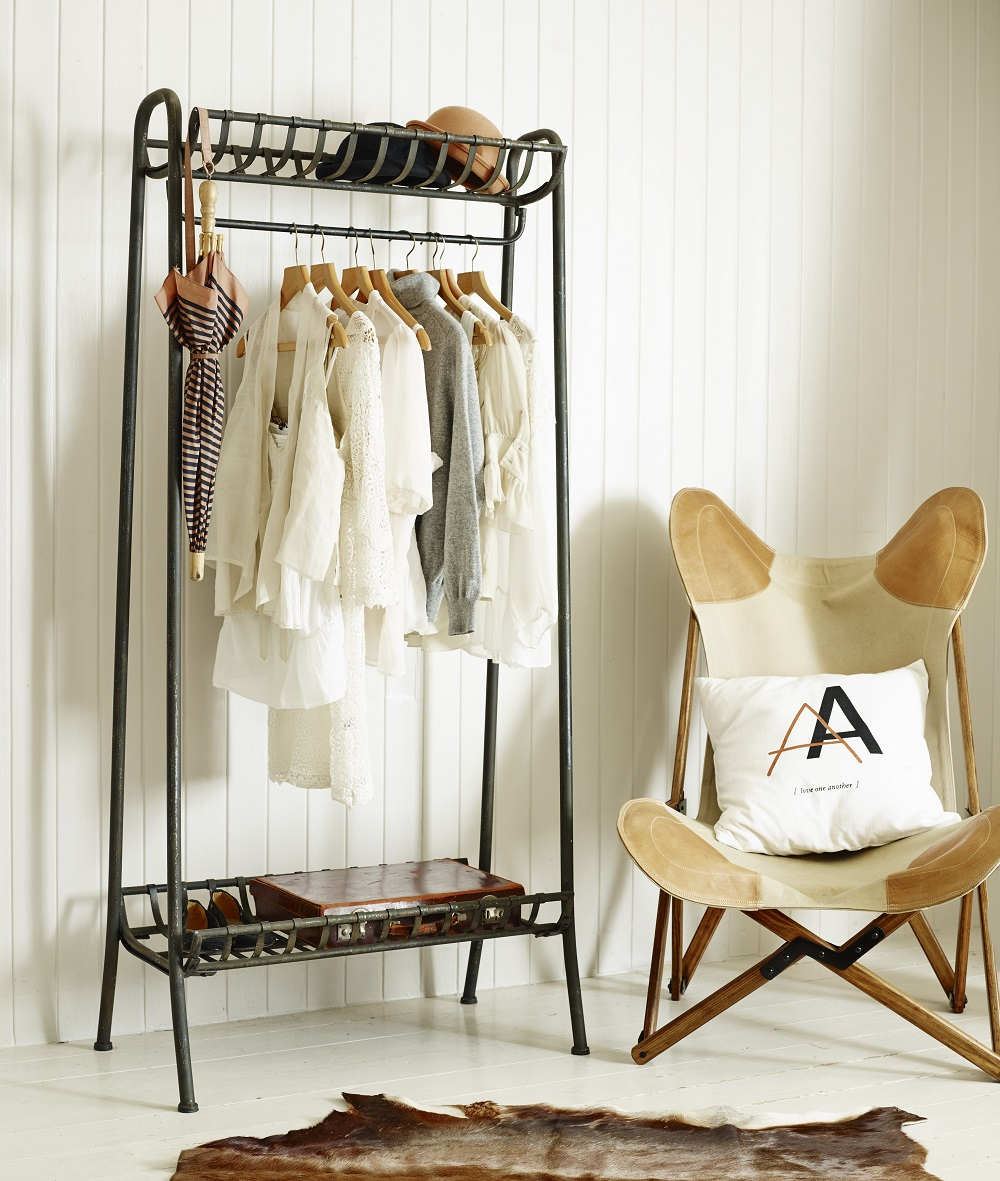 Lovable Cart Style Standing Coat Rack Made Of Metal With Black Cowhide Area Rug And Unique