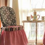 lovable coral colored  slip cover for dining room chairs with black patterned sleeve accent and round dining table