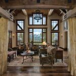 lovable interior design of wooden house with wodoen floor and log decoration and glass window and comfortable seating