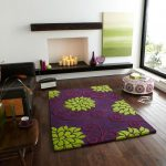 lovable interior design with purple area rug and wooden floor and round floor seating and sliding glass door