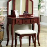 lovable marroon vanity design with triple foldable mirror and white upholstered stool