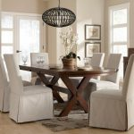 lovable white  slip cover for dining room chairs design with elegant shape and model and crossed leg wooden dining table