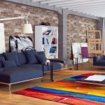 luxurious and colorful loft living room design with cheerful area rug and navy blue sofa design with stone siding and wooden ceiling and robot floor lamp