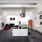 luxurious and spacious scandinavian interior design with black wooden floor and orange accent and wall units