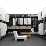 luxurious closet design idea with black and white color combination with beige dresser and white small chair