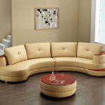 Luxurious Creamy Curved Sectional Sofa Clearance Idea With Round Red Coffee Table And Open Plan