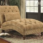 luxurious creamy small chaise lounge design with tufted pattern and wooden carved legs and patterned area rug
