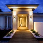 luxurious home entrance design with modern lighting and wall lamps and wooden deck with concrete planter